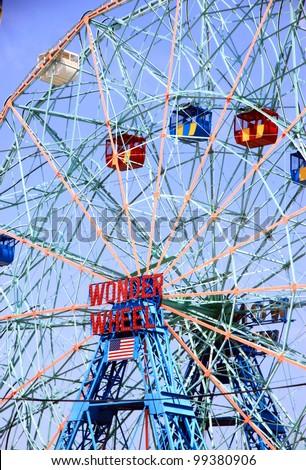 NEW YORK - JULY 16: Coney Island's Wonder Wheel on July 16, 2011 in New York. The Wonder Wheel is a 45.7-meters tall eccentric Ferris wheel located in Coney Island, Brooklyn, New York City, USA. - stock photo