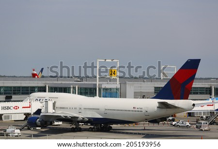 NEW YORK- JULY 10: Delta Airline Boeing 747 at the gate at the Terminal 4 at John F Kennedy International Airport in New York on July 10, 2014 - stock photo