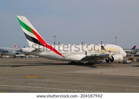 NEW YORK -JULY 10: Emirates Airline Airbus A380 at JFK Airport  in New York on July 10, 2014. The Airbus A380 is a double-deck, wide-body, world's largest passenger airliner  - stock photo