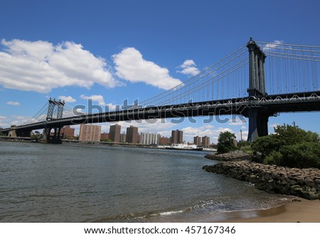 NEW YORK - JULY 21, 2016: Manhattan Bridge view. The Manhattan Bridge is a suspension bridge that crosses the East River, it was opened on December 31, 1909 and was designed by Leon Moisseiff  - stock photo