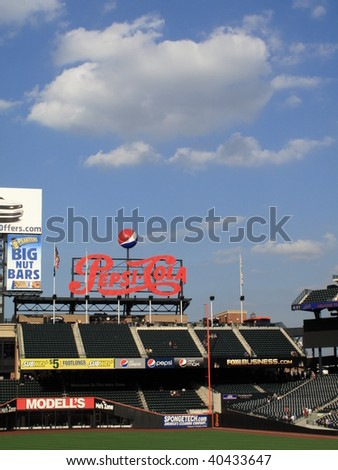 NEW YORK - JULY 30 : Mets fans watch preparations prior to a mid-season baseball game from Citi Field Pepsi Porch on July 30, 2009 in New York.