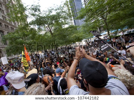 NEW YORK-JULY 11: Occupy Guitarmy protesters end their rally in Zuccotti Park by reciting their beliefs in unison during the #99MileMarch from Philly to NYC on July 11, 2012 in New York, NY. - stock photo