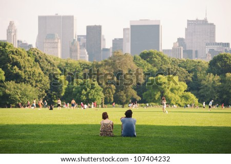 NEW YORK - JULY 1: People enjoying relaxing outdoors in Central Park on July 1, 2012 in New York. The park is the most visited urban park in the United States with 35 million visitors annually. - stock photo