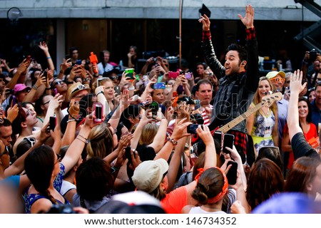 NEW YORK-JULY 19: Peter Wentz of Fall Out Boy performs on NBC's Today Show at Rockefeller Plaza on July 19, 2013 in New York City.