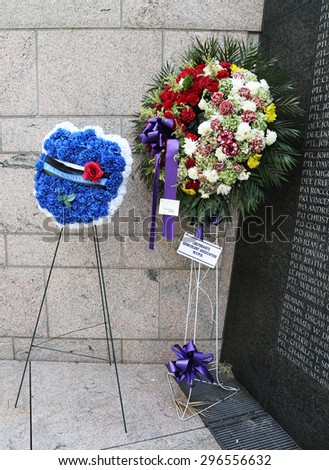 NEW YORK - JULY 11, 2015: Police Unity Tour wreath at New York City Police Memorial. Memorial created in honor of those who lost their lives in the line of duty and  was dedicated on October 20, 1997 - stock photo