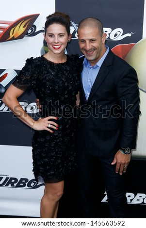 "NEW YORK-JULY 9: Race car driver Tony Kanaan and girlfriend Lauren Bohlander attend the premiere of ""Turbo"" at the AMC Loews theater at Lincoln Center on July 9, 2013 in New York City."