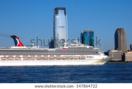 NEW YORK - JULY 29: The Carnival Glory cruise ship sails up the Hudson River into New York City, July 29, 2013. The 952-foot ship has a capacity of nearly 3,000 passengers. - stock photo