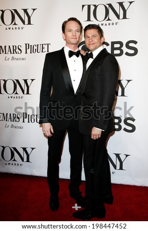 NEW YORK-JUNE 8: Actor Neil Patrick Harris (L) and David Burtka attend American Theatre Wing's 68th Annual Tony Awards at Radio City Music Hall on June 8, 2014 in New York City. - stock photo