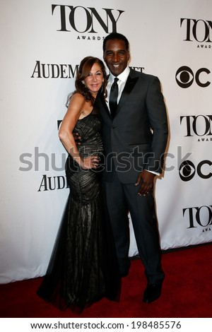 NEW YORK-JUNE 8: Actor Norm Lewis (R) and guest attend American Theatre Wing's 68th Annual Tony Awards at Radio City Music Hall on June 8, 2014 in New York City. - stock photo