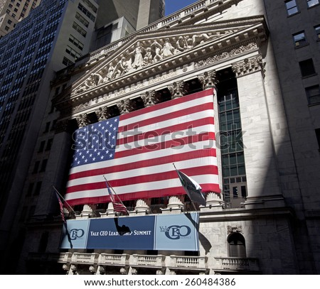 NEW YORK - JUNE 6: American flag at New York Stock Exchange in New York City. NYSE, located on the Wall Street, is the largest stock exchange counter in the world. New York, USA at June 6, 2012 - stock photo