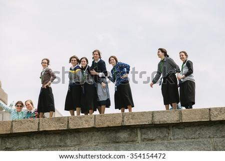 NEW YORK - JUNE 11: Amish Young Women visiting the Statue of Liberty on June 11th, 2015 in New York. New York has the fastest-growing Amish population with over 12.000 people in 89 church districts. - stock photo