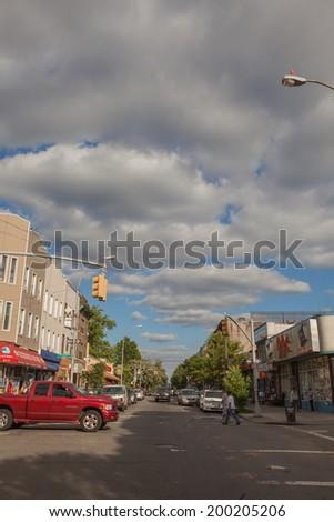 NEW YORK - JUNE 15: An Bushwick street on June 15th, 2014 in Bushwick, Brooklyn. Bushwick is a working class neighborhood in the northern part of the New York City borough of Brooklyn.  - stock photo