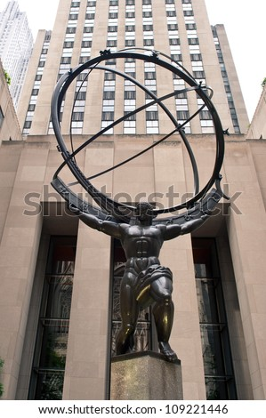 NEW YORK - JUNE 22: Atlas statue at Rockefeller Center on Fifth Avenue on June 22, 2012 in New York City. The sculpture is 15 feet tall, the entire statue is 45 feet tall, by sculptor Lee Lawrie. - stock photo