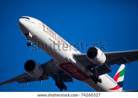 NEW YORK - JUNE 10: Boeing 777 Emirats on final approach to JFK airport located in New York, June 10, 2010. Emirates is rated as a top10 best airline in the world flying on youngest fleet - stock photo
