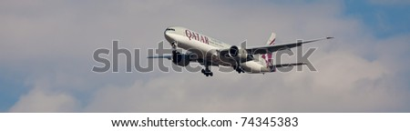 NEW YORK - JUNE 5: Boeing 777 Qatar on final approach to JFK in New York, USA on June 5, 2010. Qatar Airline is rated as top3 best airlines in the world. Qatar airline is flag carrier airline of Qatar - stock photo