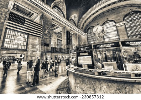 NEW YORK, JUNE 8: commuters and tourists in the grand central station in June 8, 2013 in New York. It is the largest train station in the world by number of platforms: 44, with 67 tracks. - stock photo
