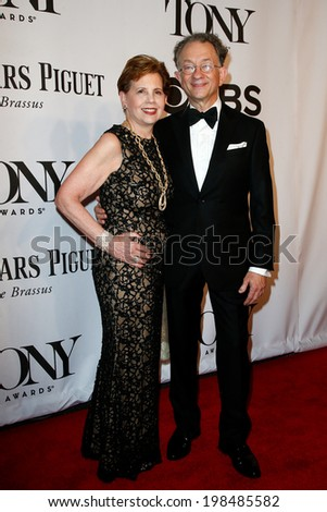 NEW YORK-JUNE 8: Costume designer William Ivey Long (R) and Adrienne Arsht attend American Theatre Wing's 68th Annual Tony Awards at Radio City Music Hall on June 8, 2014 in New York City. - stock photo