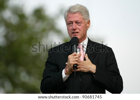 NEW YORK - JUNE 25: Former US President Bill Clinton speaks at the Greater New York Billy Graham Crusade in Flushing Meadow Corona Park June 25, 2005 in the Queens borough of New York City. - stock photo