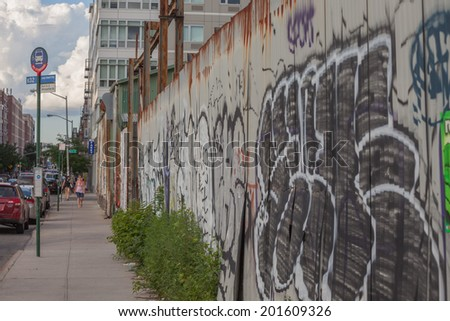 NEW YORK - JUNE 27: Graffiti on June 27th, 2014 in Brooklyn, New York. Graffiti is synonymous with Hip Hop Culture in New York City.  - stock photo