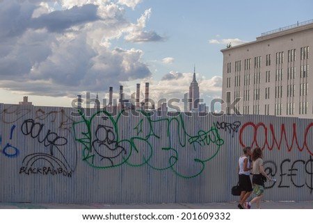 NEW YORK - JUNE 27: Graffiti on June 27th, 2014 in Brooklyn, New York. Graffiti is writing or drawings that have been scribbled, scratched, or sprayed illicitly on a wall.  - stock photo