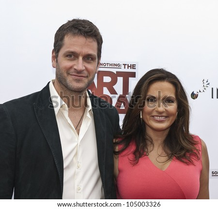 NEW YORK - JUNE 12: Mariska Hargitay and guest attend the 'Something For Nothing: The Art Of Rap' screening at Alice Tully Hall, Lincoln Center on June 12, 2012 in New York City. - stock photo