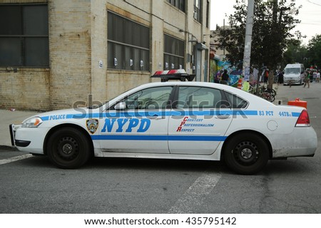 NEW YORK - JUNE 4, 2016: NYPD providing security at Hip Hop concert during Bushwick Collective Block Party in Brooklyn - stock photo