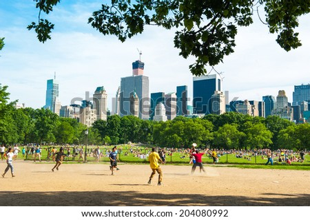 NEW YORK - JUNE 8: people in Central Park on June 8 2014 in New York. Central Park is a public park at the center of Manhattan, which opened in 1857, on 778 acres of city-owned land. - stock photo