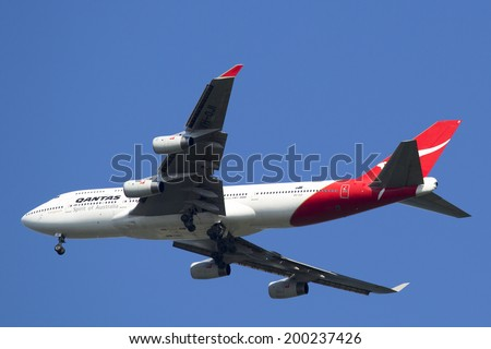 NEW YORK - JUNE 22: Qantas Airline Boeing 747-400 in New York sky before landing at JFK Airport on June 22, 2014 - stock photo