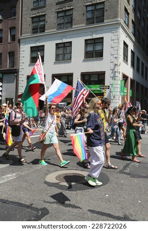 NEW YORK - June 29, 2014: Russian-Speaking American LGBT Pride Parade participants in NY on June 29, 2014. RUSA LGBT is a network for Russian-speaking LGBTQ individuals, their friends, and loved ones