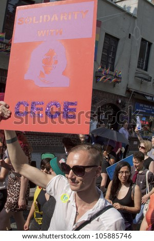 "NEW YORK - JUNE 22: Supporters carry signs with messages that include ""Solidarity With CeCe"" as they march on the 8th Annual Trans Day of Action on June 22, 2012 in New York City. - stock photo"