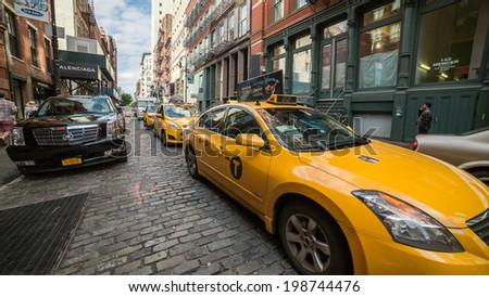 NEW YORK - JUNE 14: taxicab on June 14, 2014 in New York. Canary yellow in color, medallion taxis are able to pick up passengers anywhere in the five boroughs.