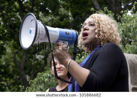 NEW YORK - JUNE 22: The Reverend Moshay Moses speaks to an audience of supporters in Washington Square Park during the 8th Annual Trans Day of Action on June 22, 2012 in New York City. - stock photo