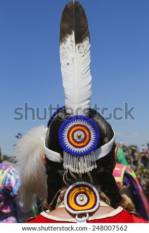 NEW YORK - JUNE 8, 2014: Unidentified female Native American dancer hair style at NYC Pow Wow in Brooklyn - stock photo