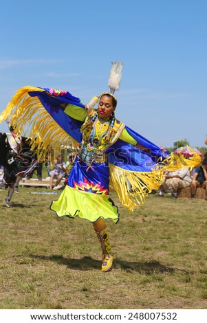NEW YORK - JUNE 8, 2014: Unidentified Native American dancer at the NYC Pow Wow in Brooklyn. A pow-wow is a gathering and Heritage Celebration of North America s Native people  - stock photo