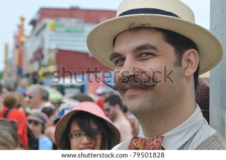 NEW YORK - JUNE 18: Unidentified participant attends Mermaid parade on Coney Island in Brooklyn on June 18, 2011 in New York City. mustache