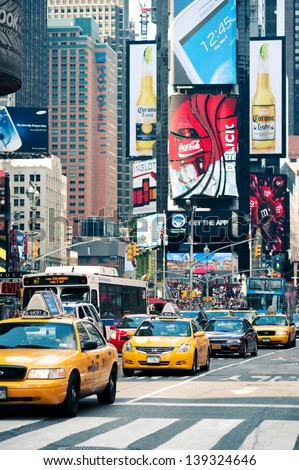 NEW YORK - JUNE 28: Yellow cabs in Times Square. T. S. is a busy tourist intersection of commerce Advertisements and a famous street of New York City and US, seen on June 28, 2012 in New York, NY. - stock photo
