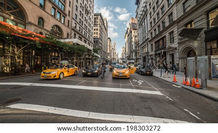 NEW YORK - JUNE 6: Yellow Cabs on June 6, 2014 in New York. Canary yellow in color, medallion taxis are able to pick up passengers anywhere in the five boroughs. - stock photo