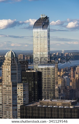 New York landmarks and attractions: One57 building with its characteristic curved top as seen from the Rock Observation Deck.One57, formerly known as Carnegie 57 is a supertall skyscraper