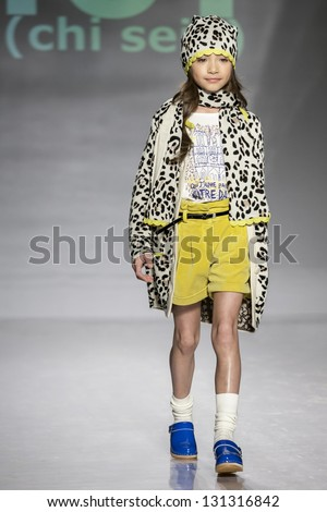 NEW YORK - MARCH 10: A model is walking the runway at Ki6 Kids Collection Show for Fall/Winter 2013 during NY Kids Fashion Week at Industria Super Studio on March 10, 2013 in New York - stock photo