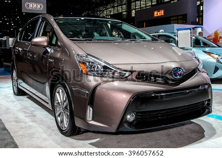 NEW YORK - March 23: A Toyota Prius V on exhibit at the 2016 New York International Auto Show during Press day,  public show is running from March 25th through April 3, 2016 in New York, NY. - stock photo