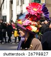 NEW YORK - MARCH 23:  A woman wears a colorful hat, during the Easter Parade on 5th Avenue, on March 23, 2008 in New York. The tradition of the Easter Parade started in the 1870's. - stock photo