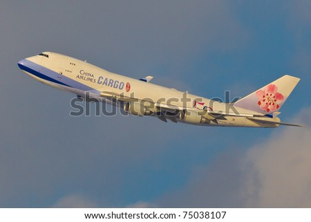 NEW YORK - MARCH 29: Boeing 747 China Airline approaching JFK airport in New York, USA on March 29, 2011. is the flag carrier of the Republic of China - commonly known as Taiwan