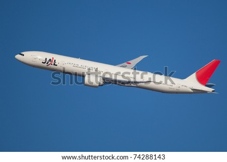 NEW YORK - MARCH 20: Boeing 777 of JAL Japan climb after take of from JFK in New York, USA, on March 20, 2011. Boeing 777 as of 2011 is the newest model build by Boeing and is used by over 50 airlines