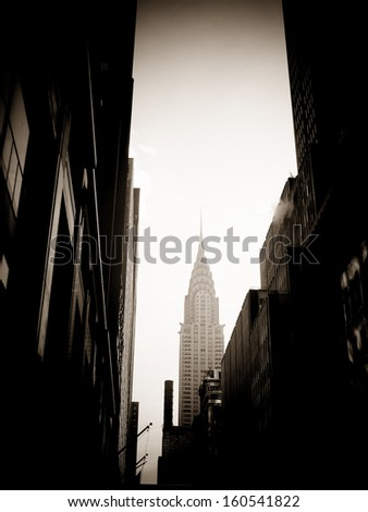 NEW YORK - MARCH 9: Chrysler building facade, pictured on on March 9, 2007 in New York, was the world's tallest building before it was surpassed by the Empire State Building in 1931  - stock photo
