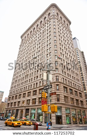 NEW YORK -MARCH 29: Flat Iron building facade on March 29, 2011. Completed in 1902, it is considered to be one of the first skyscrapers ever built. - stock photo