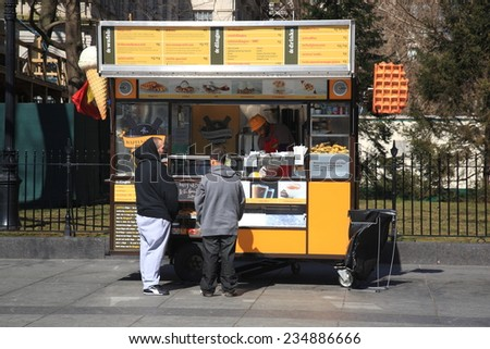 NEW YORK - March 27: Food stand on a Manhattan street on March 27, 2013 in New York. There are more than 10,000 street vendors in NYC. - stock photo