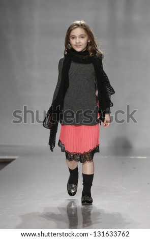 NEW YORK - MARCH 10: Girl model walks runway for petite Parade show by Ki6? (Chi sei?) during kids fashion week sponsored by Vogue Bambini at Industria Superstudio on March 10, 2013 in New York City