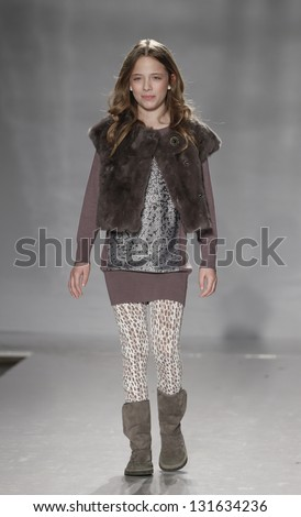 NEW YORK - MARCH 10: Girl model walks runway for petite Parade show by Silvian Heach Kids during kids fashion week sponsored by Vogue Bambini at Industria Superstudio on March 10, 2013 in New York