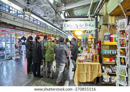 NEW YORK - MARCH 9, 2015: People shopping in Chelsea Market, Manhattan, New York City - long exposure.  The Market is an enclosed urban food court, shopping mall, and television production facility. - stock photo