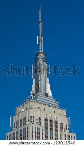 NEW YORK - MARCH 6, 2012 : The top of the Empire State Building and its viewing platform, March 6, 2012 in New York. It stood as the world's tallest building for 40 years. - stock photo